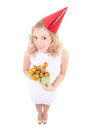 Young woman in birthday cap with flowers white dress and isolated on white background Stock Image