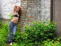 Young woman in black bra Stock Images