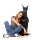 Young woman with black dobermann dog on white Royalty Free Stock Photo