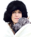 Young woman in a black fur hat Royalty Free Stock Photography