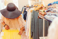 Young woman in black hat shopping in women store. Shopping time. Summer sale. Royalty Free Stock Photo