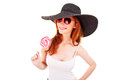 Young woman in black hat and sunglasses Royalty Free Stock Image