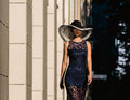Young woman in black lace dress and a hat with a wide brim. Royalty Free Stock Photo