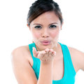 Young Woman Blowing A Kiss Royalty Free Stock Photo