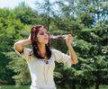 Young woman blowing soap bubbles pretty in a park Stock Photos