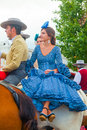 Young woman in a blue dress on horseback Royalty Free Stock Photo