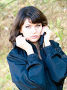 Young woman in blue jacket Stock Photography