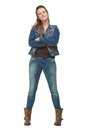 Young Woman in Blue Jeans with Arms Crossed Royalty Free Stock Photos
