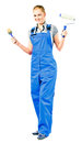 Young woman in blue overalls with painting tools Stock Images