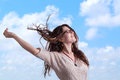 Young woman on blue sky background Stock Photography