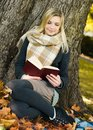 Young woman with book Royalty Free Stock Photos