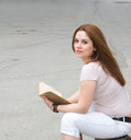 A young woman and a book Royalty Free Stock Photo