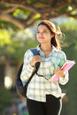 Young woman with books portrait of beautiful bag and walking in campus park Stock Photos