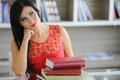 Young woman with books pretty Stock Photo