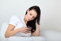Young woman with bored expression looking at message on her cell phone Royalty Free Stock Images
