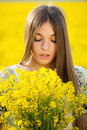 Young woman with a bouquet of yellow wildflowers cute Royalty Free Stock Images