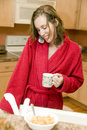 Young woman at breakfast time Royalty Free Stock Photography