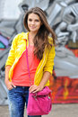 Young woman in bright clothes posing outdoors outdoor Royalty Free Stock Photography