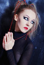 Young woman with bright gothic makeup Stock Photography