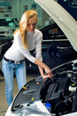 Young woman at broken car Royalty Free Stock Photography