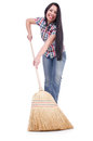 Young woman with broom isolated on white Royalty Free Stock Images
