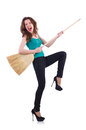 Young woman with broom isolated on white Royalty Free Stock Photo