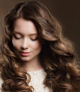 Young woman with brown hair in reverie female Stock Image