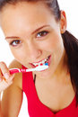 Young woman brushing her teeth isolated on white Royalty Free Stock Image