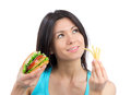Young woman with burger and french fries Royalty Free Stock Photos