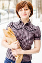Young woman buying baguettes smiling Stock Photography
