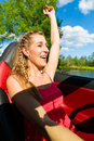 Young woman with cabriolet in summer on day trip beautiful convertible car a Stock Photos