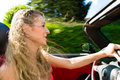 Young woman with cabriolet in summer on day trip beautiful convertible car a Stock Image
