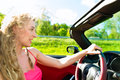 Young woman with cabriolet in summer on day trip beautiful convertible car a Stock Photography