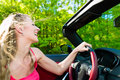 Young woman with cabriolet in summer on day trip beautiful convertible car a Royalty Free Stock Images