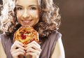Young woman with a cake curly Stock Photos
