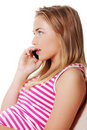 Young woman is calling with a mobile phone Royalty Free Stock Photos