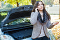Young woman calls for assistance using her cell phone after her car broke down a girl explains on the phone about car Royalty Free Stock Photo