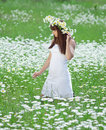 Young woman in camomile wreath in field Royalty Free Stock Photos