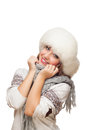 Young woman in cap covers face with scarf Royalty Free Stock Photos