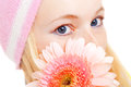 Young woman in cap with pink flower Stock Photos