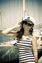 Young woman in captain cap happy on holidays on the sea Royalty Free Stock Photography