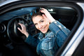 Young woman in car going on road trip.Learner driver student driving car.Driver license exam Royalty Free Stock Photo
