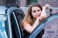 Young woman with a car key Royalty Free Stock Photos