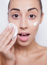 Young woman cares for face skin Royalty Free Stock Photo