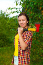 Young woman carrying an axe Stock Photos