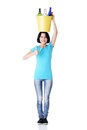 Woman carrying a bin with recyclable glass bottles. Royalty Free Stock Photo