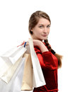 Young woman carrying many shopping bags girl isolated on white Stock Images