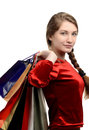 Young woman carrying many shopping bags girl isolated on white Stock Photo