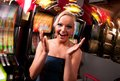 Young woman in casino on a slot machine smiling Stock Photos