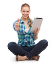 Young woman in casual clothes sitting on floor technology and internet concept smiling sitiing with tablet pc computer and showing Stock Image